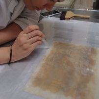 During treatment - applying toned pulp with a dropper to fill losses